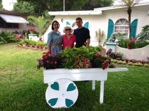 Gammy and her grandkids around the flower-cart we built her.